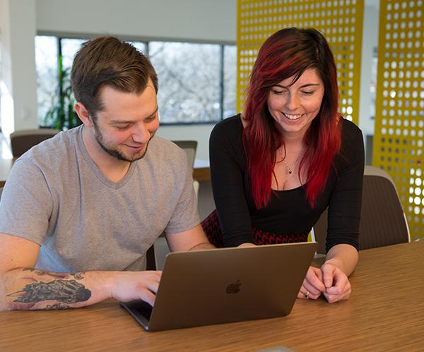 SofterWare employee working with Marketing intern