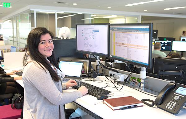 SofterWare employee working at her adjustable desk